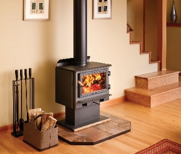 Riscaldarsi con legna o pellet come scegliere l 39 apparecchio pi adatto - Stufa a pellet per termosifoni prezzi ...